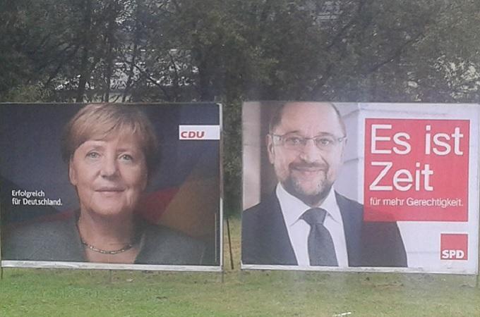 Volební plakáty: Angela Merkelová, Martin Schulz. Foto: archiv SeveročeskýDeník.cz